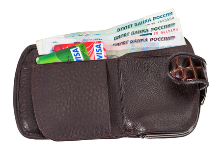 spending full: SAMARA, RUSSIA - APRIL 17, 2015: Wallet with russian rubles and credit cards, isolated on white