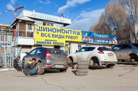 SAMARA, RUSSIA - APRIL 11, 2015: Mass replacement of automobile wheels winter to summer