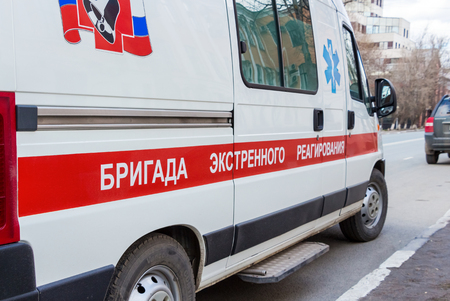SAMARA, RUSSIA - APRIL 26, 2015: Ambulance car parked up in the street. Text on russian: Team of emergency response Editorial