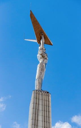 avia: SAMARA, RUSSIA - APRIL 26, 2015: Glory monument opened in 1971. A figure of a man (aviator) holding wings in his hands. Popular touristic landmark, a symbol of the city