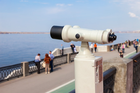 two visions: SAMARA, RUSSIA - MAY 1, 2015: Coin operated binocular on the bank of river Volga in summertime