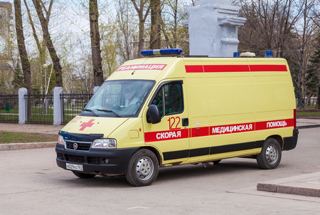humanism: SAMARA, RUSSIA - MAY 1, 2015: Ambulance car parked up in the street. Text on russian: Acute care