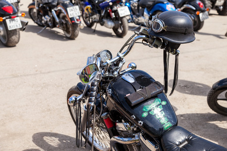 motobike: SAMARA, RUSSIA - MAY 2, 2015: Motorcycle helmet on the motobike during the traditional annual gathering of bikers Editorial