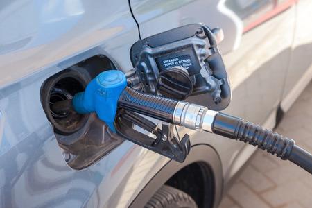 car retailer: SAMARA, RUSSIA - MAY 23, 2015: Passenger car fueled with petrol at a petrol station