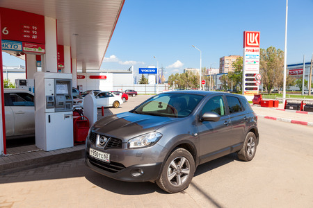 car retailer: SAMARA, RUSSIA - MAY 23, 2015: The car at the petrol station Lukoil in summer day Editorial
