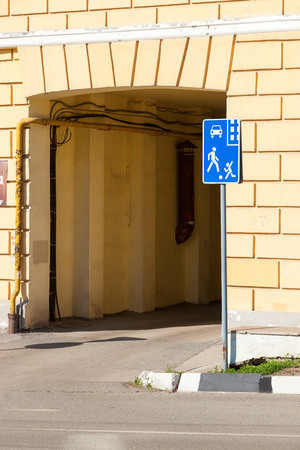 yard stick: Traffic sign living area near the entrance to the arch of an apartment house