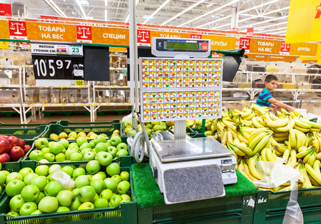 produce departments: SAMARA, RUSSIA - JUNE 13, 2015: Electronic scales in produce department of the Auchan store