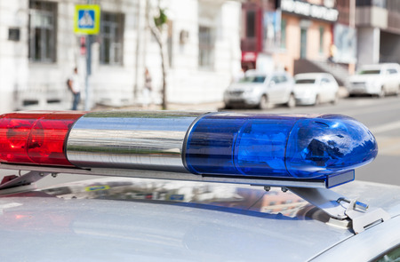 police equipment: Closeup of the colorful lights on top of a russian police vehicle