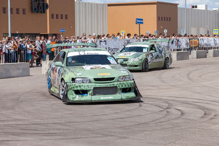 drifting: SAMARA, RUSSIA - JUNE 13, 2015: Specially designed for drifting machine stylized military themes during a speech at the auto show