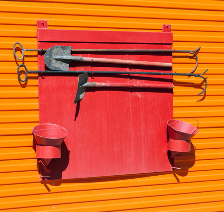 fire extinguishing: Firefighter shield with fire extinguishing tools Stock Photo