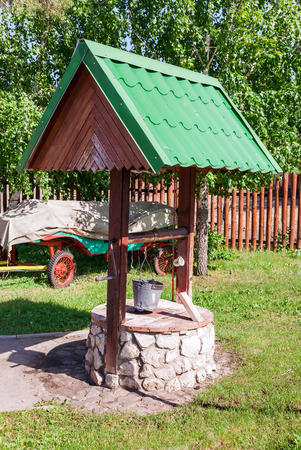 windlass: Countryside water well with a bucket