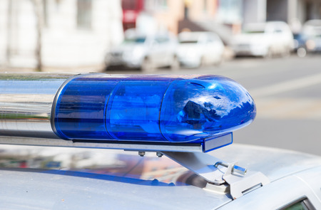 police officer: Close-up of the colorful lights on top of a russian police vehicle Stock Photo