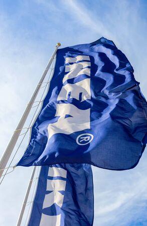 ikea: SAMARA, RUSSIA - JUNE 14, 2015: IKEA flag against sky. IKEA is the worlds largest furniture retailer