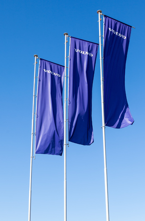 automaker: ST.PETERSBURG, RUSSIA - AUGUST 5, 2015: Volvo dealership flags over blue sky. Volvo is a Swedish multinational automaker company headquartered in Gothenburg, Sweden Editorial