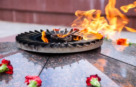 eternal: Eternal flame and flowers in memory of the Victory in the Great Patriotic War Stock Photo