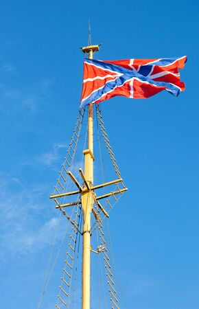 serf: Serf Russian Navy flag on the flagpole against blue sky