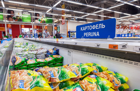 price label: VYBORG, RUSSIA - AUGUST 6, 2015: Showcase with frozen vegetables in hypermarket Karusel.  One of largest retailer in Russia Editorial