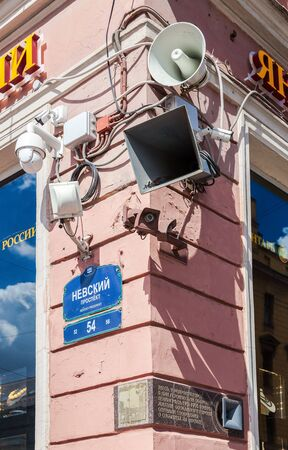 SAINT-PETERSBURG, RUSSIA - AUGUST 5, 2015:Surveillance cameras and loudspeakers on the corner of the building Editorial