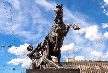 subjugation: Sculpture tamer of horses, designed by the Russian sculptor Baron Peter Klodt.  Anichkov bridge, St. Petersburg, Russia, 1841