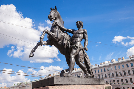 subdue: Sculpture tamer of horses, designed by the Russian sculptor Baron Peter Klodt.  Anichkov bridge, St. Petersburg, Russia, 1841