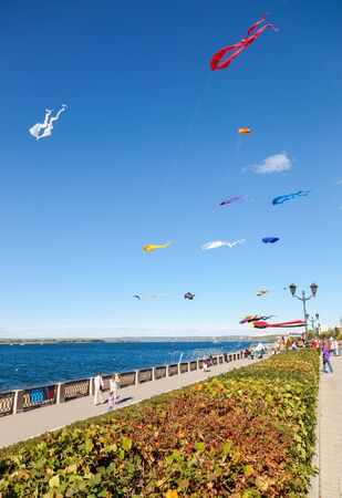 the volga river: SAMARA, RUSSIA - SEPTEMBER 12, 2015: Colorful kites flying against a blue sky on the city embankment Editorial