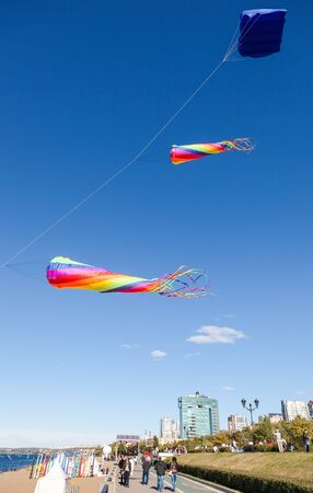 embankment: SAMARA, RUSSIA - SEPTEMBER 12, 2015: Colorful kites flying against a blue sky on the city embankment Editorial