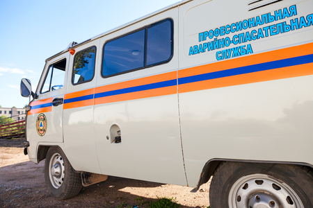 rescue service: BOROVICHI, RUSSIA - AUGUST 4, 2015: Rescue car parked up in the street. Text on russian: Professional emergency rescue service Editorial