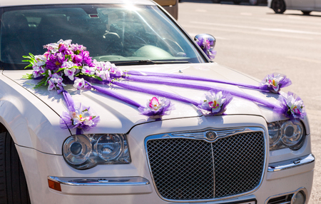 limo: ST.PETERSBURG, RUSSIA - AUGUST 7, 2015: Beautiful flowers lay on the hood of wedding car Editorial