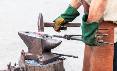 anvil: Blacksmith making a decorative element on the anvil Stock Photo