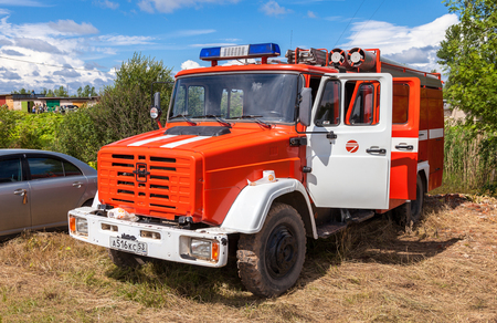accident fire truck: BOROVICHI, RUSSIA - JULY 11, 2015: Fire truck parked up in the countryside in summertime Editorial