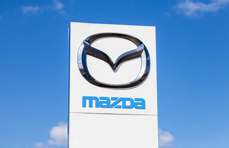 mazda: SAMARA, RUSSIA - MAY 11, 2015: Official dealership sign of Mazda. Mazda Motor Corporation is a Japanese automaker Editorial