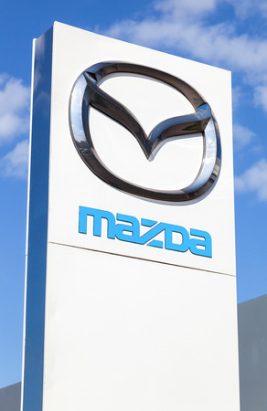 automaker: SAMARA, RUSSIA - MAY 11, 2015: Official dealership sign of Mazda. Mazda Motor Corporation is a Japanese automaker Editorial