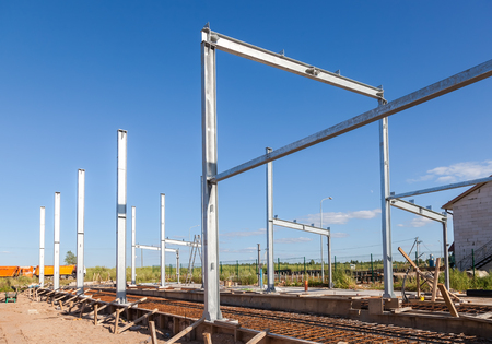 erection: Erection of metal structures in summer sunny day