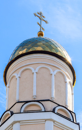 orthodox church: Golden dome of Russian orthodox church with cross against blue sky