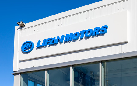 automobile dealership: SAMARA, RUSSIA - OCTOBER 4, 2015: Lifan Motors automobile dealership sign. Lifan Group is a privately owned Chinese motorcycle and automobile manufacturer