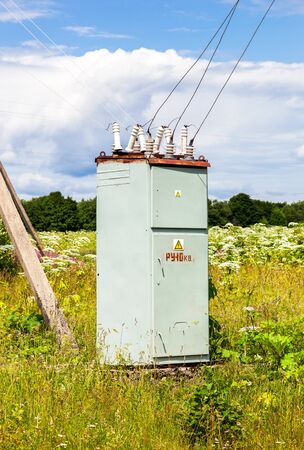 transducer: Voltage power transformer substation at the village in summertime
