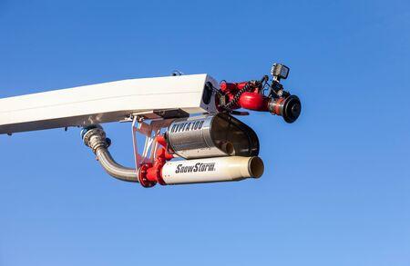 extinguishing: SAMARA, RUSSIA - NOVEMBER 7, 2015: Equipment fire extinguishing with foam Snowstorm 100  over blue sky