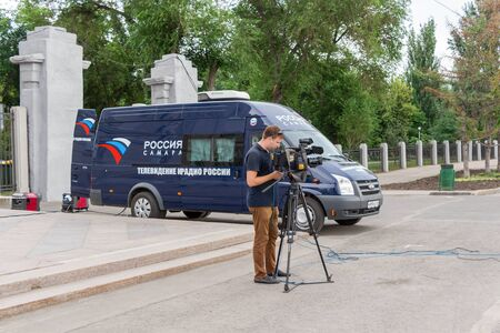 newsman: SAMARA, RUSSIA - JUNE 12, 2015: Mobile television station a state-owned Russian television channel. It belongs to the All-Russia State Television and Radio Company