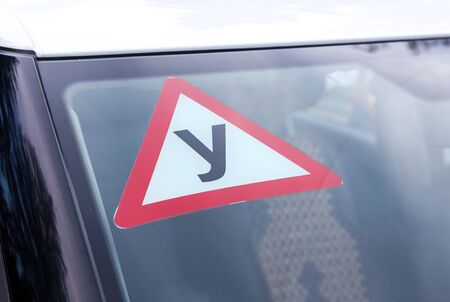 driving school: Sign of a Russian Driving School on top of the vehicle