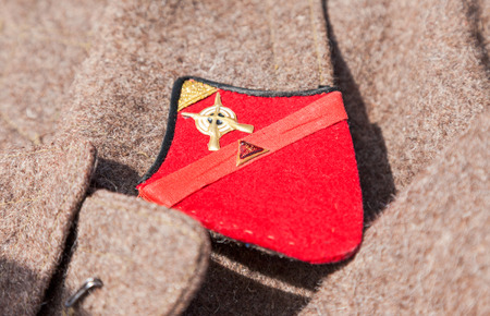 greatcoat: SAMARA, RUSSIA - JUNE 12, 2015: Distinctive sign on an old greatcoat of russian red army Editorial