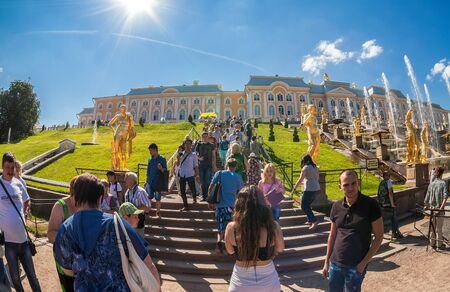 petrodvorets: ST. PETERSBURG, RUSSIA - AUGUST 6, 2014: Unidentified people near the Grand Cascade in Peterhof Palace (Petrodvorets). The Peterhof Palace included in the UNESCOs World Heritage List Editorial