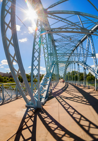 steel arch bridge: BOROVICHI, RUSSIA - JULY 11, 2014: First in Russia steel arch bridge on river Msta. Was build in 1905