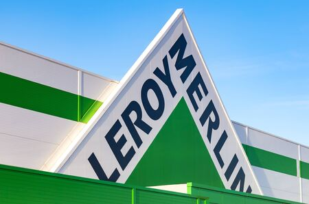 merlin: SAMARA, RUSSIA - NOVEMBER 29, 2015: Leroy Merlin brand sign against blue sky. Leroy Merlin is a French home-improvement and gardening retailer serving thirteen countries