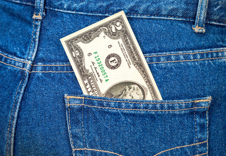 two us dollar: Two dollars bill sticking out of the back jeans pocket