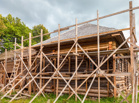 roof ridge: Reconstruction of old wooden house in russian village Stock Photo