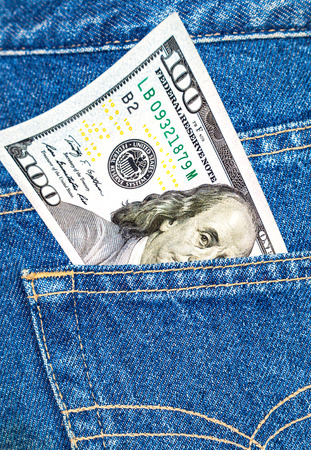 cotton  jeans: One hundred dollars bill sticking out of the blue jeans pocket Stock Photo
