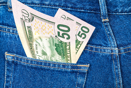 u s: Banknotes of fifty U. S. dollars bill sticking out of the back jeans pocket Stock Photo