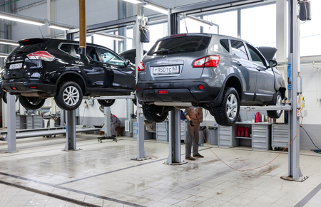auto lift: SAMARA, RUSSIA - JANUARY 10, 2016: Inside in the auto repair service station of the official dealer Nissan. Nissan is a Japanese multinational automaker