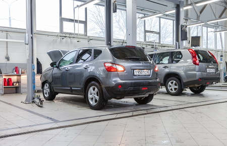 automaker: SAMARA, RUSSIA - JANUARY 10, 2016: Inside in the auto repair service station of the official dealer Nissan. Nissan is a Japanese multinational automaker