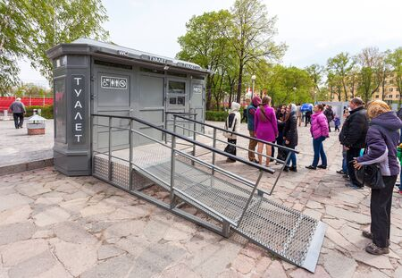 SAMARA, RUSSIA - MAY 9, 2015: People stand in a queue near the public toilet